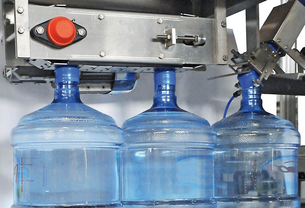Dây chuyền sản xuất nước lavie Máy đóng nắp kiểu ấn - Press On Capper
