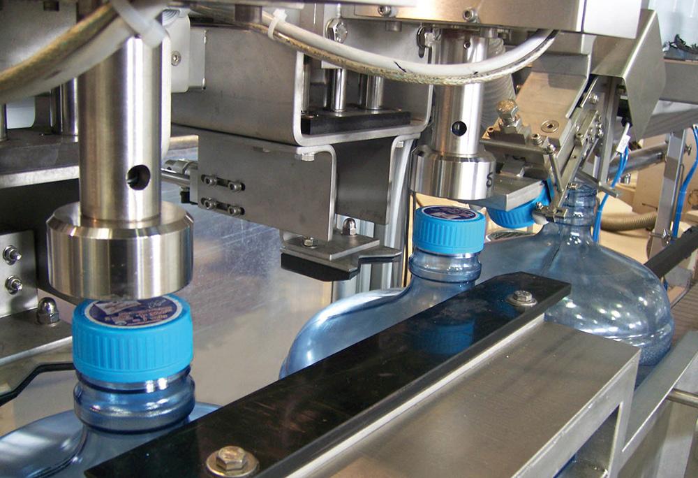 Dây chuyền sản xuất nước lavie Máy đóng nắp kiểu vặn - Screw capper