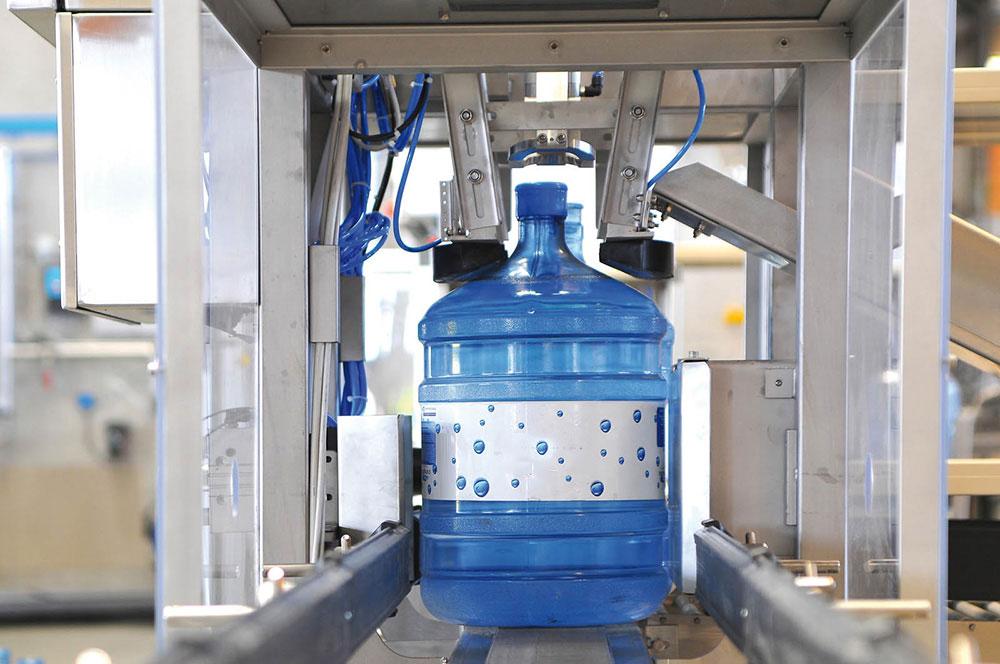 Dây chuyền sản xuất nước lavie - Máy giật nắp